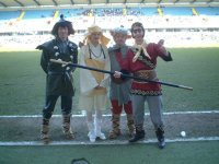 Monkey, Pigsy, Sandy and Tripitaka on the pitch at Millwall football ground