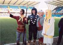 Monkey, Pigsy, Sandy and Tripitaka on the pitch at Millwall football ground - Monkey calls for his cloud!